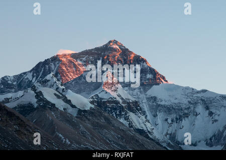 View of Mountain Everest, the highest peak on Earth, at sunset. Viewed from the north (Tibet) side. - Stock Photo