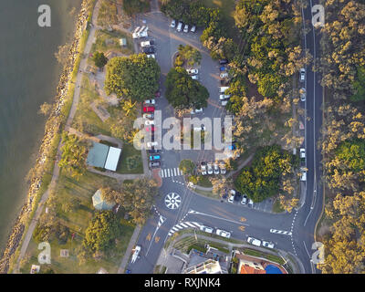 Aerial houses showing Queensland homes at sunset. The urban area show roads, buildings, trees and car parks in Sunshine Coast, Queensland, Australia. - Stock Photo