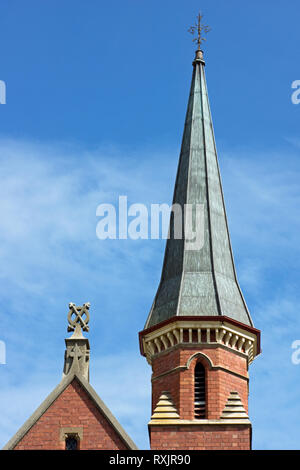 Australian small town church spire and church facade, side and aerial view, in Victoria, Australia. - Stock Photo