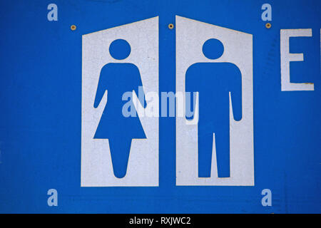 Bathroom Sign Showing Woman Man And Handicapped Symbols