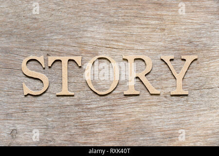 Alphabet letter in word story on wood background - Stock Photo