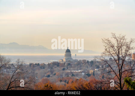 Utah State Capital Building towering over city - Stock Photo