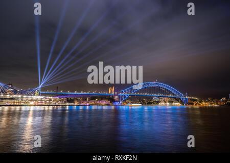 Sydney, Australia - Sydney Harbour Bridge illuminated during Vivid Sydney, the annual festival of light, music and ideas. - Stock Photo