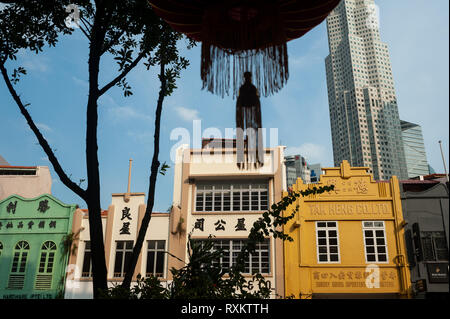 08.03.2019, Singapore, Republic of Singapore, Asia - Old buildings along South Bridge Road with modern skyscraper of the central business district. - Stock Photo