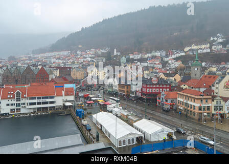 Looking down over the Fish Market of Bergen City on a wet, misty day, with People hurrying around doing there Saturday Shopping. Bergen, Norway. - Stock Photo