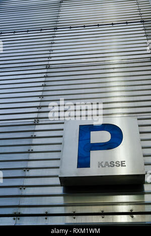 Note on the cash register in a parking garage in Berlin - Stock Photo