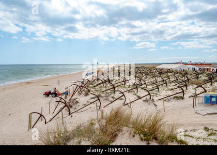 Cemetery of anchors on the beach at Praia Do Barril in Santa Luzia, Algarve, Portugal, - Stock Photo
