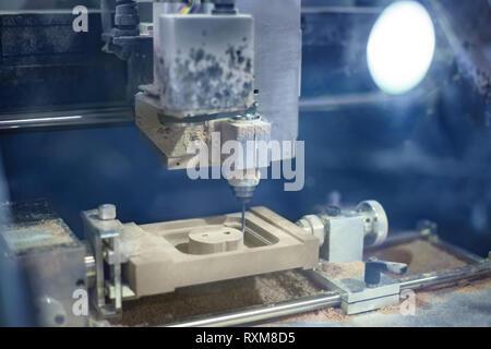CNC engraving - milling machine during work - Stock Photo