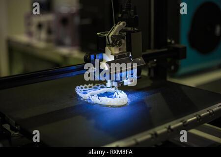Automatic three dimensional 3D printer machine printing plastic model - Stock Photo