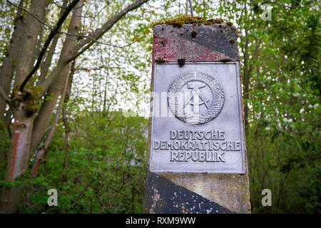 Border pillar of the former inner German border in a forest near Braunlage - Stock Photo