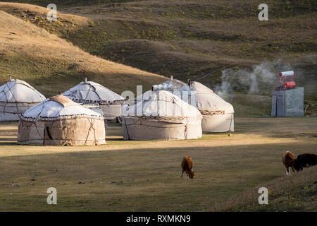 Tulpar, Kyrgyzstan August 21 2018: Yurt Base Camp at Tulpar Lake at the foot of Peak Lenin in Kyrgyzstan - Stock Photo