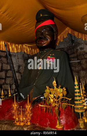 Cm680Cambodia, Phnom Penh, Oudong, statue of man with moustache in military uniform inside small vihara - Stock Photo