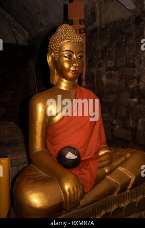 Cambodia, Phnom Penh, Oudong, Vihear Preah Ath Roes, golden Buddha statue with monks alms bowl and robe in reconstructed vihar - Stock Photo