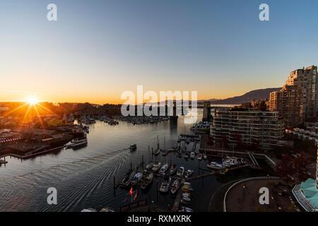The sun sets over False Creek and Burrard Street Bridge, Vancouver, British Columbia, Canada - Stock Photo