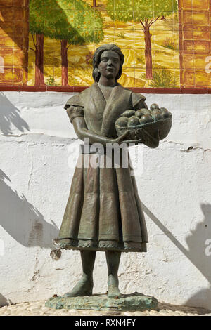 Homage to the worker woman (Homenaje a la faenera). Älora, Málaga province, Andalusia, Spain. - Stock Photo