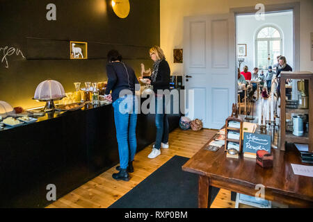 The Kavaliershaus has a lot to offer families with children. Everyone gets their money's worth at the breakfast buffet in the former classroom. Breakfast in Hotel Kavaliershof in Fincken, Germany - Stock Photo