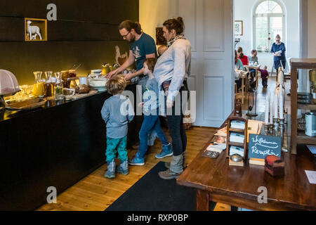 The Kavaliershaus has a lot to offer families with children. Everyone gets their money's worth at the breakfast buffet in the classroom of Hotel Kavaliershof in Fincken, Germany - Stock Photo