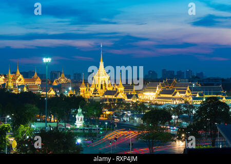 Sanam luang park with golden spears at night in Bangkok, Thailand - Stock Photo