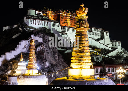 Night view of the illuminated Potala palace in Lhasa old town in Tibet, China - Stock Photo