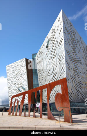 Two of the four projecting segments that make up Belfast's Titanic Museum. They evoque ships' prows ploughing through the North Atlantic swell. Belfast, Northern Ireland - Stock Photo