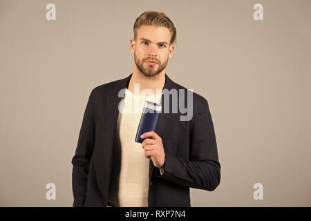 Always confident in my shampoo. Man stylish hairstyle holds bottle matte product grey background. Make thicker use matte styling paste or clay. Matte product absorb light and make hair appear thicker. - Stock Photo