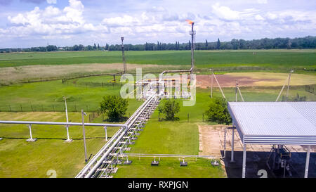 Flare for flaring associated gas. The end point of the pressure relief system on the oil facility - Stock Photo