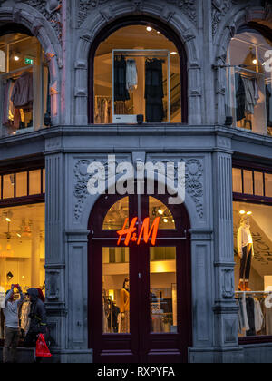 Amsterdam, Netherlands - August 26, 2018: H&M store in Paris. H & M Hennes & Mauritz AB is a Swedish multinational retail-clothing company, known for  - Stock Photo