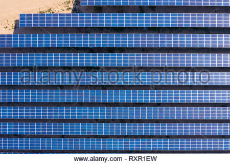 Aerial view of solar panels set in the California desert - Stock Photo