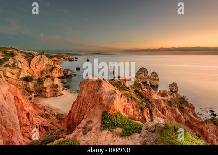 Amazing landscape at sunrise. Beautiful beach near Lagos in Ponta da Piedade, Algarve region, Portugal.  Seascape with Cliff rocks. Portugal vacations - Stock Photo