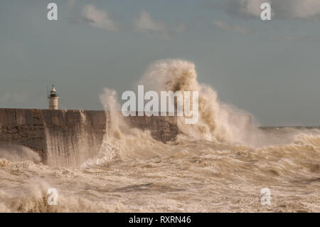 Newhaven, East Sussex, UK. 10th Mar 2019. A bright very breezy day on the South coast brings out photographers and wave watchers. Some amazing scenes.Credit: - Stock Photo