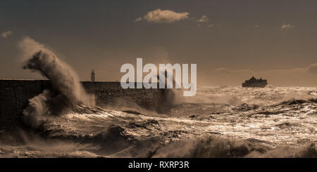 Newhaven, South Coast. 10th Mar 2019. UK Weather: Big waves hit the South Coast of Newhaven, East Sussex. Ferry leaving port of Newhaven Credit: Lloyd Lane/Alamy Live News - Stock Photo