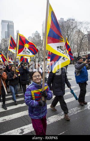 New York, USA. 10th Mar 2019. Tibetans in exile gathered in NY City at the United Nations on March 10, 2019,  marking the 60th Anniversary of the Tibetan Uprising and marched to the Chinese Consulate to protest the ongoing occupation of Tibet and oppression of the Tibetan people and culture. Credit: David Grossman/Alamy Live News - Stock Photo