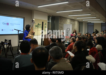 (190311) -- NEW YORK, March 11, 2019 (Xinhua) -- An artist performs pipa solo 'Green Waist' during the launch ceremony of an educational program on traditional Chinese music at the China Institute's headquarters in New York, the United States, on March 10, 2019. The New York City-based China Institute launched a new educational program on traditional Chinese music in partnership with the Bard College Conservatory of Music (BCCM) on Sunday. Starting from spring 2019, the 'Music at China Institute' will offer classes on guqin, erhu, and guzheng, each with eight sessions. Founded in 1926, China - Stock Photo