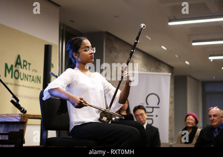 (190311) -- NEW YORK, March 11, 2019 (Xinhua) -- A student performs erhu solo 'Happily Ship Crops' during the launch ceremony of an educational program on traditional Chinese music at the China Institute's headquarters in New York, the United States, on March 10, 2019. The New York City-based China Institute launched a new educational program on traditional Chinese music in partnership with the Bard College Conservatory of Music (BCCM) on Sunday. Starting from spring 2019, the 'Music at China Institute' will offer classes on guqin, erhu, and guzheng, each with eight sessions. Founded in 1926, - Stock Photo