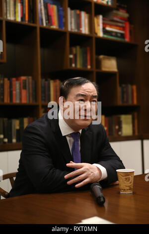 (190311) -- NEW YORK, March 11, 2019 (Xinhua) -- Yu Feng, president of the Central Conservatory of Music in Beijing, receives an interview with Xinhua prior to the launch ceremony of an educational program on traditional Chinese music at the China Institute's headquarters in New York, the United States, on March 10, 2019. The New York City-based China Institute launched a new educational program on traditional Chinese music in partnership with the Bard College Conservatory of Music (BCCM) on Sunday. Starting from spring 2019, the 'Music at China Institute' will offer classes on guqin, erhu, a - Stock Photo