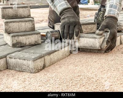 Paver laying driveway pavement out of concrete pavement
