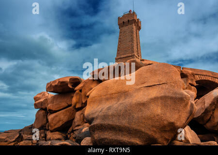 The lighthouse at Ploumanach on the Cote de Granite Rose in the Cotes-d Armor, Brittany, France - Stock Photo