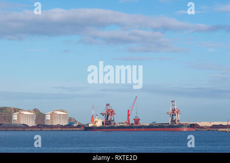 Gijón, Asturias, Spain - march 07 2019 Coal cargo ship moored in port with lifting cargo cranes, ships and grain - Stock Photo