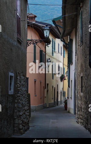 Cityscape, an old alley in Sulzano on the shore of Lake Iseo in Italy - Stock Photo