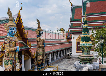 Two colored thotsakhirithon (giant demons) in the Temple of Emerald Buddha - Stock Photo