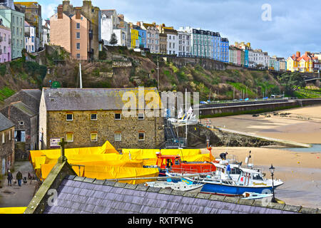 A view of the colourful houses overlooking the harbour and North Beach in the Welsh seaside resort of Tenby, S.Wales - Stock Photo