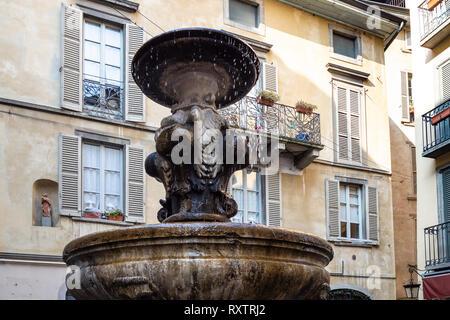 Travel to Italy - fountain Fontana Del Gombito (Fontana di San Pancrazio) on street via Gombito in Citta Alta (Upper Town) of Bergamo city, Lombardy - Stock Photo