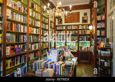 Woman reading, interior of Faulkner House Books, bookstore selling William Faulkner's books, Pirate's Alley, New Orleans French Quarter, New Orleans,  - Stock Photo