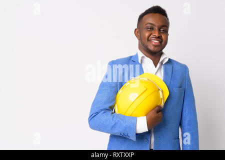 Portrait of happy young African businessman holding hardhat