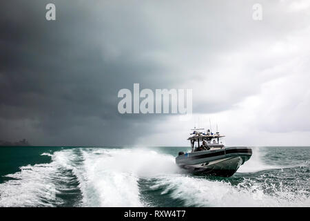 Marine Interdiction agents with U.S. Customs and Border Protection Air and Marine Operations (AMO) on board a Coastal Interceptor Vessel (CIV) with a maximum speed of 58 knots and range of 402 miles. See description for more information. - Stock Photo