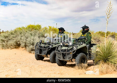United States Customs and Border Protection (USCBP) officers guard the US-Mexico international border near the Santa Teresa Port of Entry in New Mexico on quad bikes. See more information below. - Stock Photo