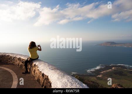 Selfie with panoramic view of Graciosa Island. Mirador del Rio, Lanzarote. Spain - Stock Photo