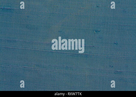 Close up of a woolen fabric of grey-blue color. Abstract canvas background, empty template. - Stock Photo