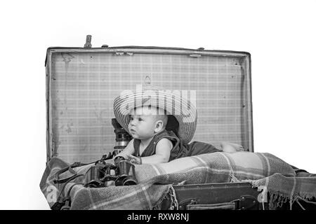 Taking care of a baby. Small girl in suitcase. Traveling and adventure. Portrait of happy little child. Sweet little baby. New life and birth - Stock Photo