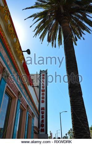 Los Angeles, California, USA - September 22, 2018: Colorful house facade of Hollywood Museum, a palm tree nearby, blue sky, sunny - Stock Photo